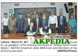 A Contract bieng signed by Wapda