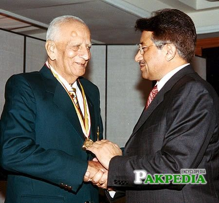 receiving medal from Pakistan president during the Golden Jubilee of Test Cricket Gala, Islamabad, September 16, 2003