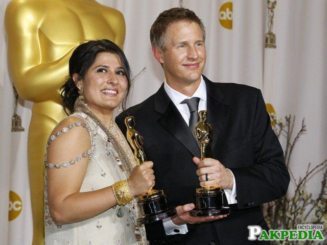 Directors Sharmeen Obaid-Chinoy (L) and Daniel Junge, winners of the Best