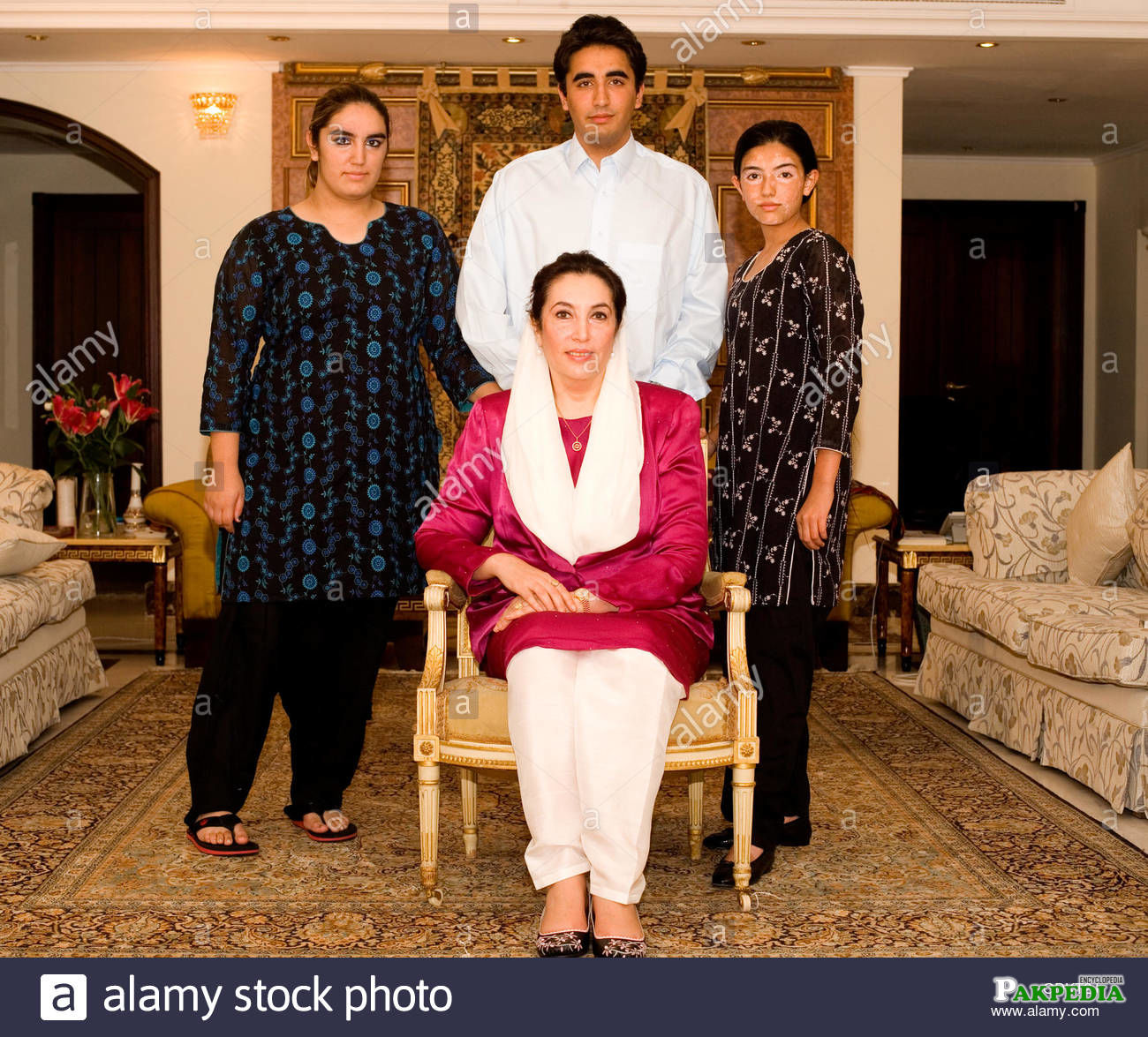 With siblings and mother