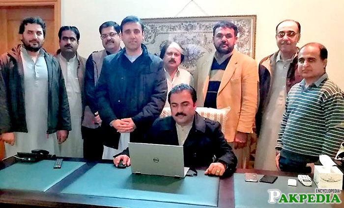 Rehmat Saleh Baloch on Laptop