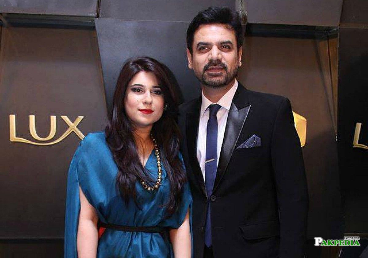 Vasay chaudhry with his wife in a Lux style award