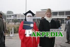 With his daughter on her convocation day