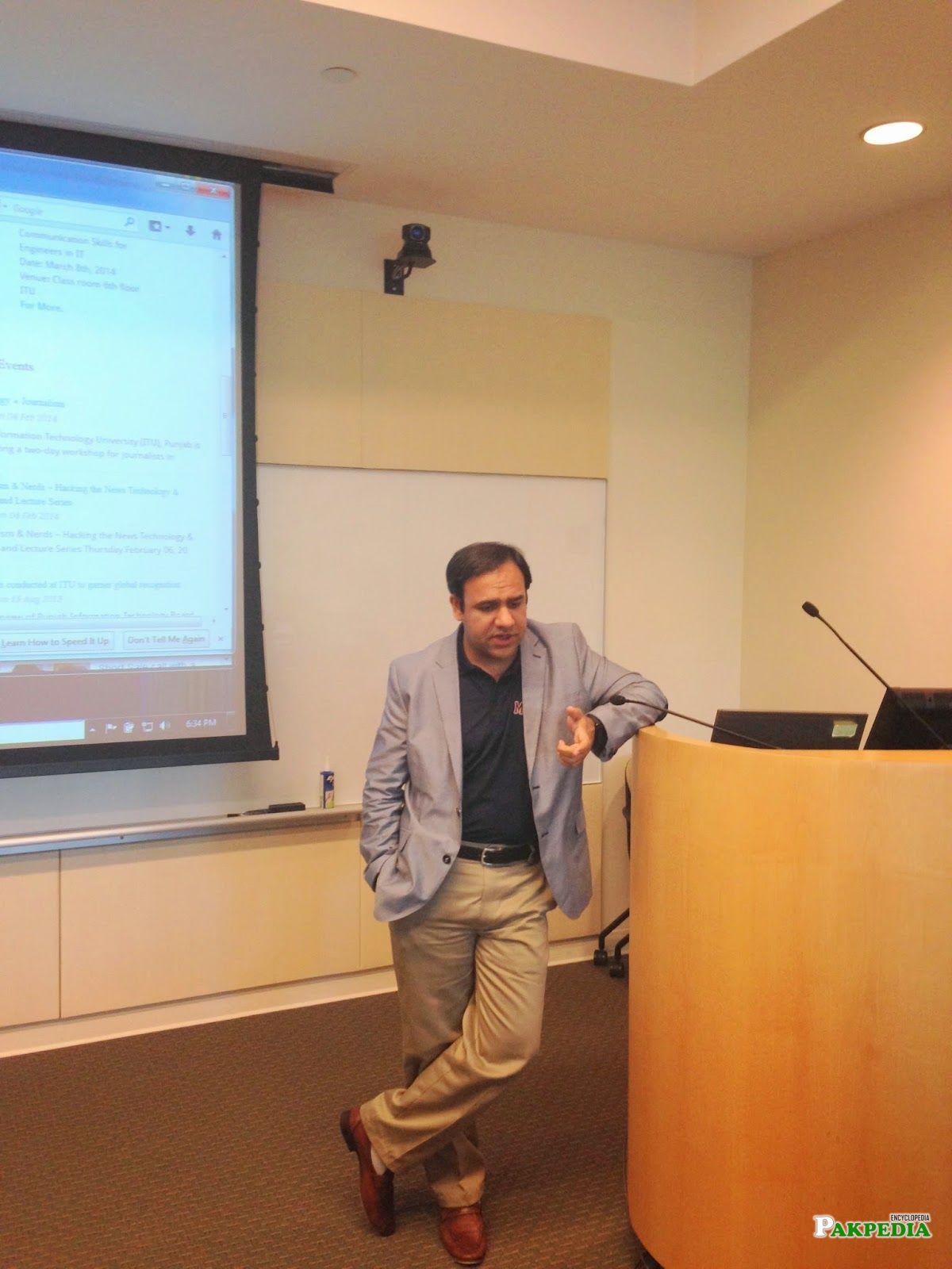 Dr umar while delivering presentation
