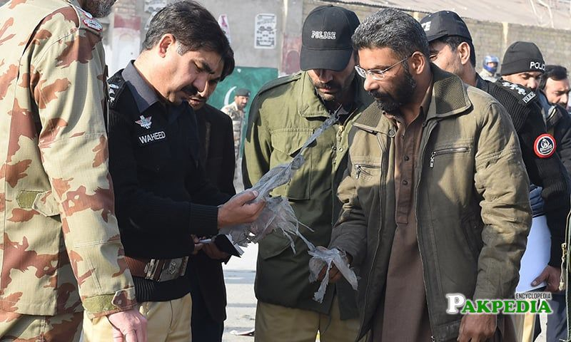 With Police Officers During Investigation