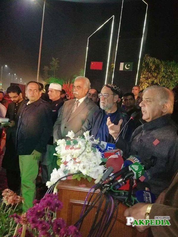 Shaikh Rohale Asghar with Shahbaz Sharif while addressing to the people