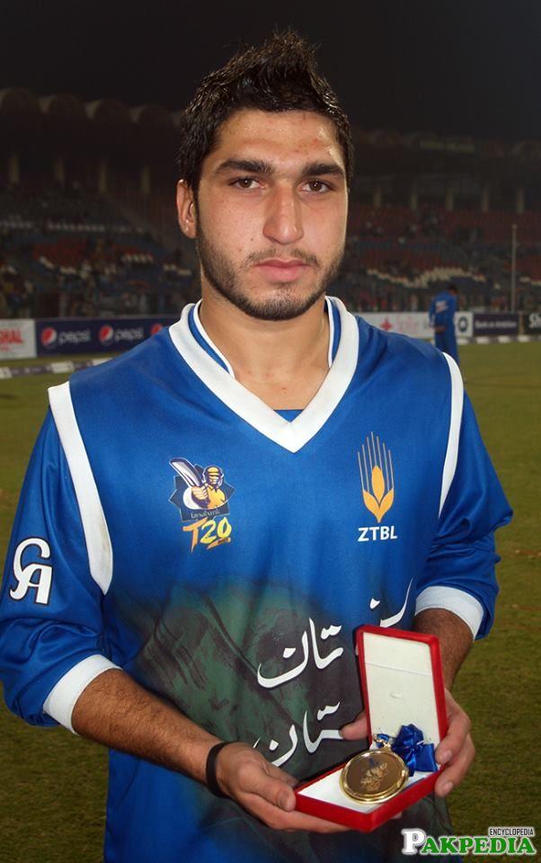 Usman Khan recieving an award