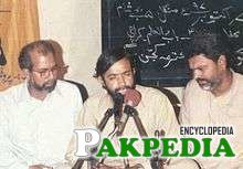 Zaidi performing with his companions, Hussain Akhtar and Shakeel Haider.