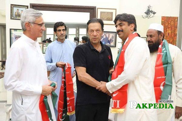 Abdul Hayi Dasti with Imran Khan at his office