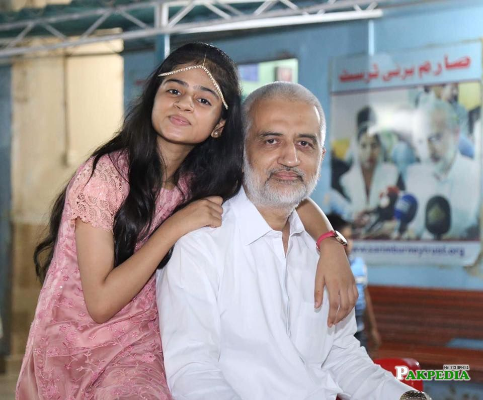 With his daughter Syeda burney