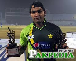 Umar Akmal with Tow Troffies