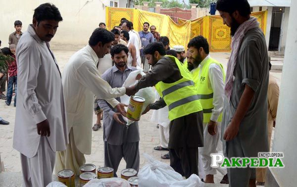 People of FIF Distributing goods among people