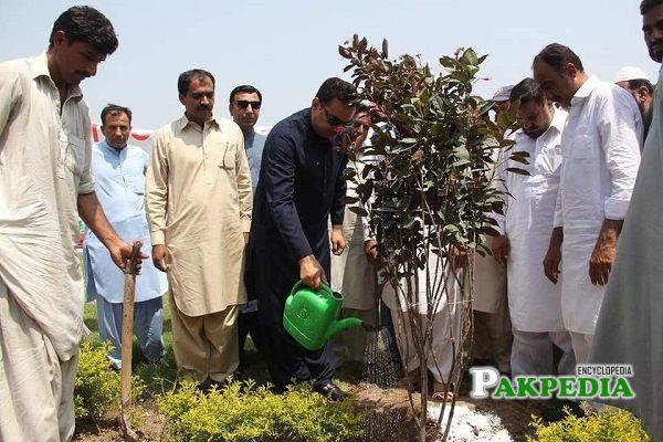 Faisal Farooq while planting tress on PM call
