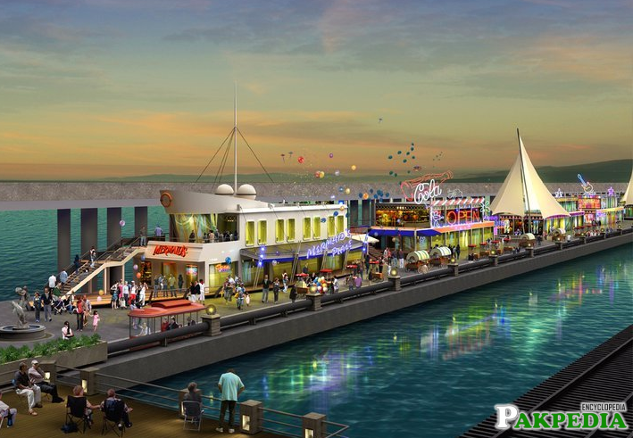 A food street along the sea– you can watch the ships here, take a cruise, shop, eat, or watch the fire dance